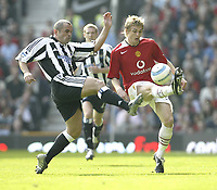 Fotball<br /> England 2004/2005<br /> Foto: SBI/Digitalsport<br /> NORWAY ONLY<br /> <br /> Manchester United v Newcastle United<br /> FA Barclays Premiership<br /> Old Trafford<br /> 24/04/2005<br /> <br /> Manchester's Darren Fletcher and Newcastle's Steven Carr