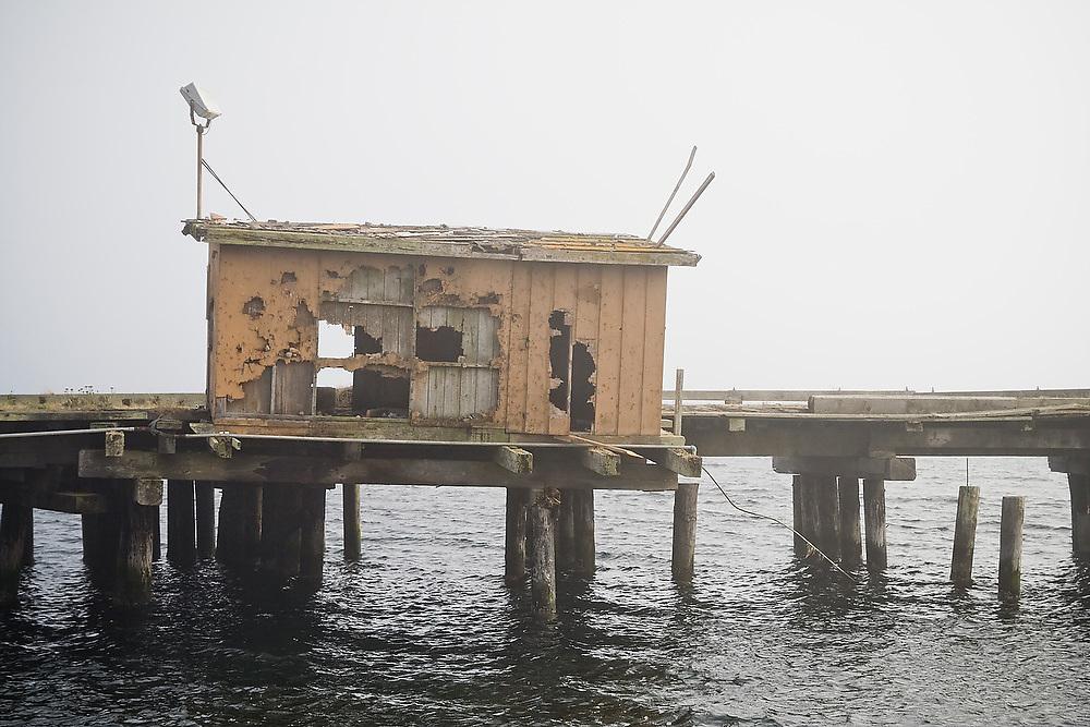 An abandoned and derelict pier on Ediz Hook in Port Angeles Harbor, Washington.