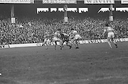 Dublin is outnumbered by Kerry as they tackle him during the All Ireland Senior Gaelic Football Final, Kerry v Dublin in Croke Park on the 28th September 1975. Kerry 2-12 Dublin 0-11.