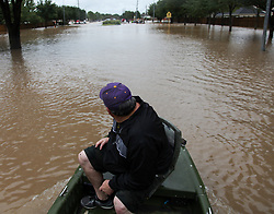 August 29, 2017 - Houston, Texas, U.S. - A rescue boat heads towards stranded residents in Katy's Grande Lakes during rescue operations from flooding caused by Hurricane Harvey. (Credit Image: © John Glaser/CSM via ZUMA Wire)