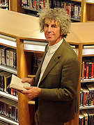 © Licensed to London News Pictures. 21/11/2011, London, UK. The Library's Architect, Piers Gough, from CZWG Architects.  London's Southwark Council previews Canada Water Library its new 'super library', featuring a 150-seat theatre, restaurant and cafe, evening class space community meeting rooms and Tube station entrance and exit. The building opens to the public on November 28. Photo credit : Stephen Simpson/LNP