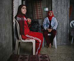 Huda Ghalia, 12, is seen with with her sister Omuma, 13, inside their home in Gaza, Palestinian Territories, Nov. 24, 2006. Ghalia gained attention after members of her family were killed in an explosion that Palestinians say was caused by Israeli artillery fire, a charge Israel denies. According to Human Rights Watch, since September 2005, Israel has fired about 15,000 rounds at Gaza while Palestinian militants have fired around 1,700 back.