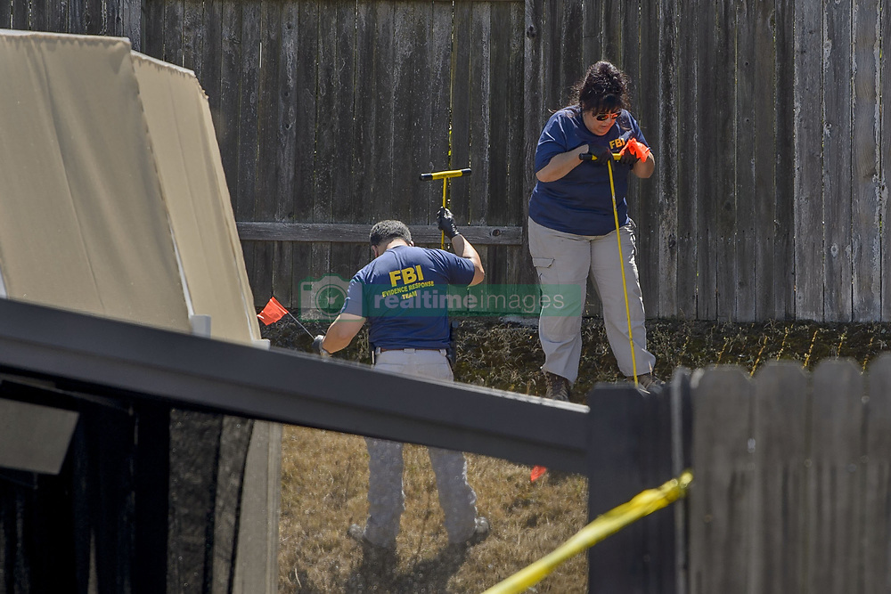 April 25, 2018 - Citrus Heights, California, U.S. - Law enforcement authorities process evidence at the home of suspected 'East Area Rapist' at his home in Citrus Heights on Wednesday. Sacramento law enforcement leaders announced Wednesday they arrested Joseph James Deangelo, the man they believe was the East Area Rapist, also known as the Golden State Killer, who killed and terrorized people in the 1970s and 1980s. (Credit Image: © Randall Benton/Sacramento Bee via ZUMA Wire)