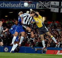 Photo: Ed Godden.<br /> Chelsea v Newcastle United. The FA Cup. 22/03/2006.<br /> Chelseas Eidur Gudjohnsen (L) in the air, fails to get to the ball.