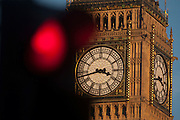 A red traffic light in the foreground and the clockface containing the Big Ben bell in the Elizabeth Tower of the British parliament, on 17th January 2017, in London England. The Elizabeth Tower (previously called the Clock Tower) named in tribute to Queen Elizabeth II in her Diamond Jubilee year – was raised as a part of Charles Barry's design for a new palace, after the old Palace of Westminster was largely destroyed by fire on the night of 16 October 1834. The new Parliament was built in a Neo-gothic style. Although Barry was the chief architect of the Palace, he turned to Augustus Pugin for the design of the clock tower. It celebrated its 150th anniversary on 31 May 2009. The tower was completed in 1858 and has become one of the most prominent symbols of both London and England.