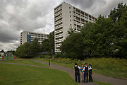 Three police officers talking to a member of the public at the Loughborough Estate on 3rd August 2016 in the London Borough of Lambeth, London, United Kingdom.