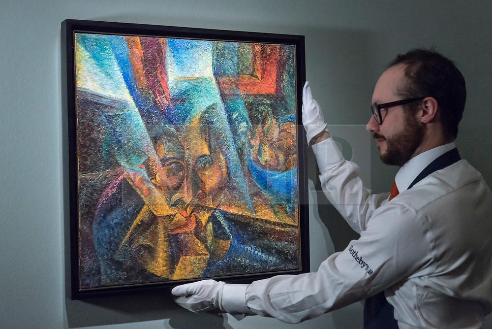 © Licensed to London News Pictures. 22/02/2018. LONDON, UK. A technician presents ''Testa + Luce + Ambiente'' by Umberto Boccioni, (Est. £5,500,000 - 7,500,000) at the preview of Sotheby's upcoming Impressionist, Modern & Surrealist Art auctions taking place at Sotheby's, New Bond Street, on 28 February. Photo credit: Stephen Chung/LNP