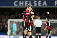 Simon Francis of Bournemouth hugs Adam Smith of Bournemouth after the final whistle. Barclays Premier league match, Chelsea v AFC Bournemouth at Stamford Bridge in London on Saturday 5th December 2015.<br /> pic by John Patrick Fletcher, Andrew Orchard sports photography.