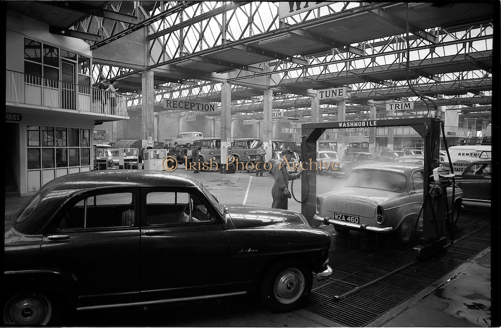 06/09/1962<br /> 09/06/1962<br /> 06 September 1962<br /> Workshop hall at McCairns Motors Ltd., Santry, Dublin. Note the car wash and the array of trucks and cars.