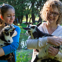 Candace and Cachell Cox with kid goats.