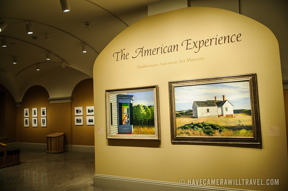 Entrance to the American Experience exhibit at the Smithsonian American Art Museum. Painting on left is Cape Cod Morning (1950) by Edward Hopper. On right is Ryder's House (1933) by Edward Hopper.