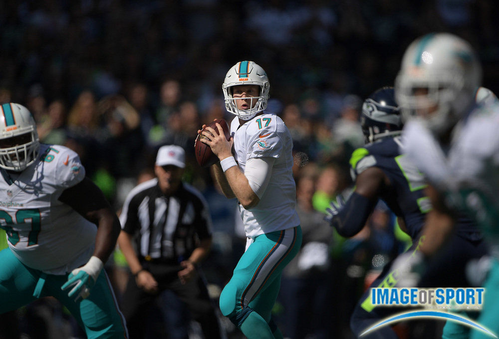 Sep 11, 2016; Seattle, WA, USA; Miami Dolphins quarterback Ryan Tannehill (17) throws a pass against the Seattle Seahawks during a NFL game at CenturyLink Field.