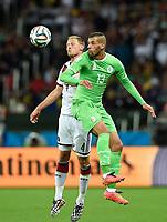 Fotball<br /> Tyskland v Algerie<br /> 30.06.2014<br /> VM 2014<br /> Foto: Witters/Digitalsport<br /> NORWAY ONLY<br /> <br /> v.l. Benedikt Höwedes (Deutschland), Islam Slimani<br /> Fussball, FIFA WM 2014 in Brasilien, Achtelfinale, Deutschland - Algerien