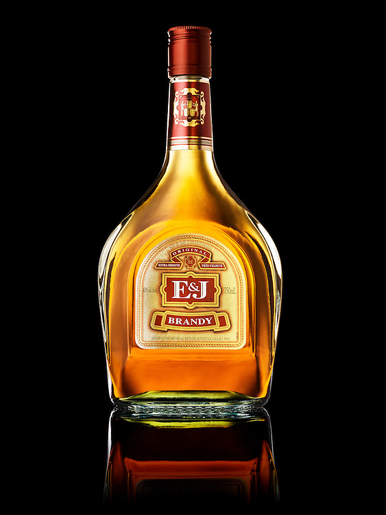 Beauty bottle of E&J Bandy on a black reflective surface Ray Massey is an established, award winning, UK professional  photographer, shooting creative advertising and editorial images from his stunning studio in a converted church in Camden Town, London NW1. Ray Massey specialises in drinks and liquids, still life and hands, product, gymnastics, special effects (sfx) and location photography. He is particularly known for dynamic high speed action shots of pours, bubbles, splashes and explosions in beers, champagnes, sodas, cocktails and beverages of all descriptions, as well as perfumes, paint, ink, water – even ice! Ray Massey works throughout the world with advertising agencies, designers, design groups, PR companies and directly with clients. He regularly manages the entire creative process, including post-production composition, manipulation and retouching, working with his team of retouchers to produce final images ready for publication.