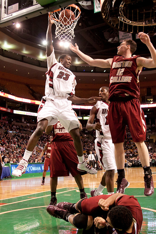 UMass guard, Sean Carter, dunks on Boston College players during second half action at TD Garden in Boston, Massachusetts.