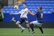 George Newell (Bolton Wanderers) and John Welsh (Preston North End) during the Pre-Season Friendly match between Bolton Wanderers and Preston North End at the Macron Stadium, Bolton, England on 30 July 2016. Photo by Mark P Doherty.