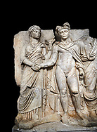 """Roman Sebasteion relief sculpture of emperor Claudius and Agrippina, Aphrodisias Museum, Aphrodisias, Turkey.   Against a black background.<br /> <br /> Claudius in heroic nudity and military cloak shakes hands with his wife Agrippina and is crowned by the Roman people or the Senate wearing a toga. The subject is imperial concord with the traditional Roman state. Agrippina holds ears of wheat: like Demeter goddess of fertility. The emperor is crowned with an oak wreath, the Corona civica or """"citizen crow"""", awarded to Roman leaders for saving citizens lives: the emperor id therefore represented as saviour of the people. .<br /> <br /> If you prefer to buy from our ALAMY STOCK LIBRARY page at https://www.alamy.com/portfolio/paul-williams-funkystock/greco-roman-sculptures.html . Type -    Aphrodisias     - into LOWER SEARCH WITHIN GALLERY box - Refine search by adding a subject, place, background colour, museum etc.<br /> <br /> Visit our ROMAN WORLD PHOTO COLLECTIONS for more photos to download or buy as wall art prints https://funkystock.photoshelter.com/gallery-collection/The-Romans-Art-Artefacts-Antiquities-Historic-Sites-Pictures-Images/C0000r2uLJJo9_s0"""