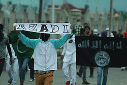 September 2, 2017 - Srinagar, Jammu And Kashmir, India - Massive clashes broke out between youth and government forces in south Kashmirs Anantnag district some 50 kilometers from summer capital of Indian controlled Kashmir on the eve of Id-ul-Azha. As soon as Eid prayers concluded at Hanfia Eidgah youth held protest demonstrations.They were chanting pro-Islam and pro freedom slogans.The protesters later clashed with police  and paramilitary forces deployed in strength outside.Youth hurled stones and bricks on the forces who lobbed tear shells,used sound shells,pepper and pellets. (Credit Image: © Ubaid Ullah Wani/Pacific Press via ZUMA Wire)