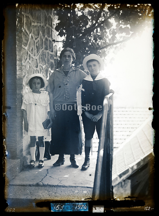 mother with dressed up children circa 1930s France