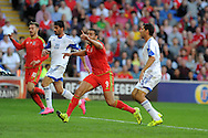 Hal Robson-Kanu of Wales reacts after the ball appeared to hit the arm of Eytan Tibi of Israel (r) but despite appeals for handball to referee Ivan Bebek no penalty is given.  Euro 2016 qualifying match, Wales v Israel at the Cardiff city stadium in Cardiff, South Wales on Sunday 6th Sept 2015.  pic by Andrew Orchard, Andrew Orchard sports photography.