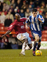 Photo: Leigh Quinnell.<br /> Bristol City v Huddersfield Town. Coca Cola League 1. 10/02/2007. Bristol Citys Wayne Andrews tackles Huddersfields Matthew Young.