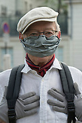"""April, 9th 2020 - Paris, Ile-de-France, France: Parisians wearing a range of masks and facial coverings in the hope of protecting themselves from the spread of the Coronavirus, during the first month of near total lockdown imposed in France. A week after President of France, Emmanuel Macron, said the citizens must stay at home for at least 15 days, that has been extended. He said """"We are at war, a public health war, certainly but we are at war, against an invisible and elusive enemy"""". All journeys outside the home unless justified for essential professional or health reasons are outlawed. Anyone flouting the new regulations is fined. Nigel Dickinson"""
