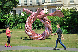 """© Licensed to London News Pictures. 05/07/2017. London, UK. """"Fiddlers Fortune"""", 2010, by John Chamberlain.  The Frieze Sculpture festival opens to the public in Regent's Park.  Featuring outdoor works by leading artists from around the world the sculptures are on display from 5 July to 8 October 2017.  Photo credit : Stephen Chung/LNP"""