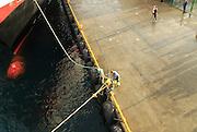 Hurtigruten ferry ship arriving at quayside of port quayside of Rorvik, Norway