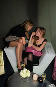 Leonie Frieda and Kate Goldsmith. party given by Daphne Guinness for Christian Louboutin  after the opening of his new shopt.  Baglione Hotel. 16 March 2004.  ONE TIME USE ONLY - DO NOT ARCHIVE  © Copyright Photograph by Dafydd Jones 66 Stockwell Park Rd. London SW9 0DA Tel 020 7733 0108 www.dafjones.com