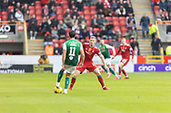 Aberdeen's Lewis Ferguson (19) and Joe Newell (11) of Hibernian battles for possession, tussles, tackles, challenges, during the Cinch Scottish Premiership match between Aberdeen and Hibernian at Pittodrie Stadium, Aberdeen, Scotland on 23 October 2021.