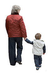Grandmother taking young boy to nursery,