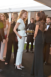 Left, NATALIA VODIANOVA at the Chovgan Twilight Polo Gala in association with the PNN Group held at Ham Polo Club, Petersham Close, Richmond, Surrey on 10th September 2014.