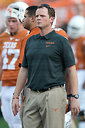 AUSTIN, TX - AUGUST 31: Co-offensive coordinator Major Applewhite of the Texas Longhorns looks on before kickoff against the New Mexico State Aggies on August 31, 2013 at Darrell K Royal-Texas Memorial Stadium in Austin, Texas.  (Photo by Cooper Neill/Getty Images) *** Local Caption *** Major Applewhite
