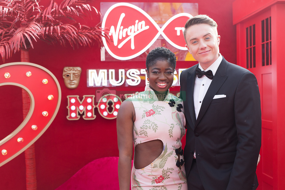 EDITORIAL USE ONLY<br /> BAFTA host Clara Amfo with Virgin TV's red-carpet host Roman Kemp in Virgin TV's Must-See Moment Lounge at the Virgin TV British Academy Television Awards.