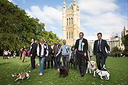 London, UK. Thursday 10th October 2013. MPs and their dogs competing in the Westminster Dog of the Year competition celebrates the unique bond between man and dog - and aims to promote responsible dog ownership.