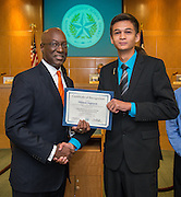Houston ISD Interim Superintendent Ken Huewitt and Denis Nguyen pose for a photograph during a meeting of the Board of Trustees, June 9, 2016.