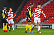 Charlie Goode of Scunthorpe United (20) and Andrew Butler of Doncaster Rovers (6) exchange a few words with smiles on their faces during the EFL Sky Bet League 1 match between Doncaster Rovers and Scunthorpe United at the Keepmoat Stadium, Doncaster, England on 15 December 2018.