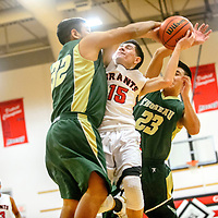 Thoreau Hawks Elias Ramone (32), left, and Shayne Tahe (23) attack Grants Pirate Eric Gonzales (15)  during the Eddie Peña Holiday Classic at Grants High School Thursday.