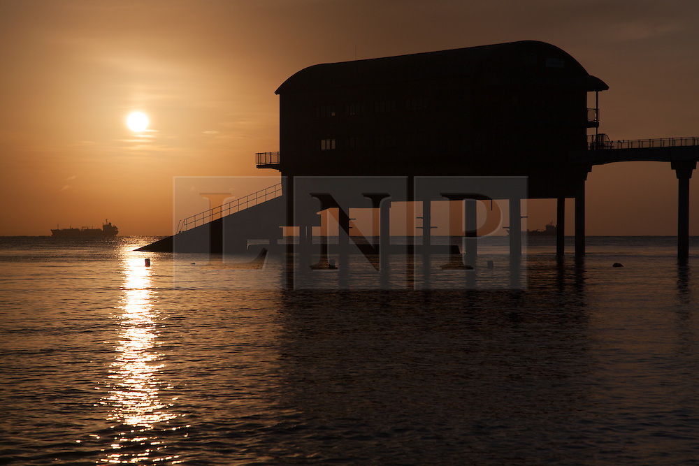 © Licensed to London News Pictures. 22/05/2015. Bembridge, UK. The lifeboat station at Bembridge on the Isle of Wight at sunrise this morning, Friday 22nd May 2015. The Bank Holiday weekend is set to be warm with sunny spells in the South of England. Photo credit : Rob Arnold/LNP