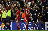Photo: Paul Thomas.<br /> Liverpool v Bordeaux. UEFA Champions League, Group C. 31/10/2006.<br /> <br /> Liverpool's John Arne Riise (6) looks on as Referee Markus Merk (Yellow) sends off Menegazzo Fernando (Far R) for hitting Riise.