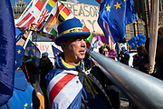 Anti Brexit protester Steve Bray with his giant megaphone in Westminster as the Prime Minister arrives in Brussels to request an extension to Article 50 so the UK can continue to try to agree a Brexit Withdrawal Agreement on 10th April 2019 in London, England, United Kingdom. With just two days until the UK is supposed to be leaving the European Union, the delay decision awaits.