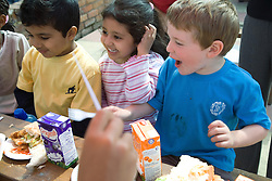Children on a day out enjoying a snack,