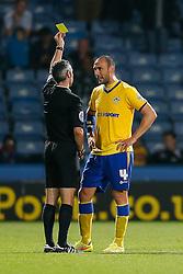 Ivan Ramis of Wigan is shown a yellow card by referee Sebastian Stockbridge for a foul on Joel Lynch of Huddersfield - Photo mandatory by-line: Rogan Thomson/JMP - 07966 386802 - 16/09/2014 - SPORT - FOOTBALL - Huddersfield, England - The John Smith's Stadium - Huddersfield Town v Wigan Athletic - Sky Bet Championship.