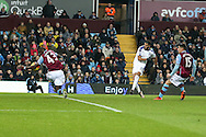 A shot from Leicester city's Riyad Mahrez ® hits the arm of Aly Cissokho of Aston Villa (43) and a penalty is awarded. Barclays Premier league match, Aston Villa v Leicester city at Villa Park in Birmingham, The Midlands on Saturday 16th January 2016.<br /> pic by Andrew Orchard, Andrew Orchard sports photography.