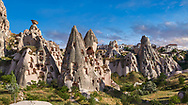 Pictures & images of Uchisar Castle & the cave houses in the rock formations & fairy chimney of Uchisar, near Goreme, Cappadocia, Nevsehir, Turkey .<br /> <br /> If you prefer to buy from our ALAMY PHOTO LIBRARY  Collection visit : https://www.alamy.com/portfolio/paul-williams-funkystock/cappadociaturkey.html (TIP refine search - type which part of Cappadocia into the LOWER search box)<br /> <br /> Visit our TURKEY PHOTO COLLECTIONS for more photos to download or buy as wall art prints https://funkystock.photoshelter.com/gallery-collection/3f-Pictures-of-Turkey-Turkey-Photos-Images-Fotos/C0000U.hJWkZxAbg