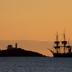Cape Nedick Light and a replica of Captain Cook's S.S. Endeavor.  York, ME