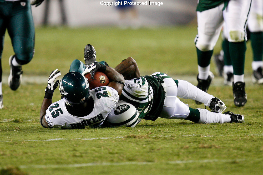 28 August 2008: Philadelphia Eagles running back Lorenzo Booker #25 is brought down by New York Jets cornerback Ahmad Carroll #42 during the game against the New York Jets on August 28, 2008. The Jets beat the Eagles 27 to 20 at Lincoln Financial Field in Phialdelphia, Pennsylvania.