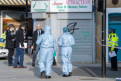 © Licensed to London News Pictures. 08/03/2021. London, UK. Forensic investigators on White Hart Lane after a man was found with fatal stab injuries on Penshurst Road, a second man, who is 18-years-old, was treated for stab wounds and taken to hospital. Photo credit: Peter Manning/LNP
