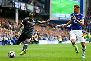 Victor Moses of Chelsea crosses the ball under pressure from Dominic Calvert-Lewin of Everton. Premier league match, Everton v Chelsea at Goodison Park in Liverpool, Merseyside on Sunday 30th April 2017.<br /> pic by Chris Stading, Andrew Orchard sports photography.