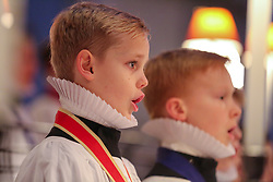 © Licensed to London News Pictures. 19/12/2018. London, UK. Choristers rehearse Christmas favourites, under the direction of Andrew Carwood, Director of Music at St Paul's Cathedral. In December the Choristers of St Paul's will sing to more than 20,000 people during a series of services and concerts. It is estimated that on the 23rd, 24th and 25th of December alone, more than 10,000 people will come through the doors of St Paul's for Christmas services. Photo credit: Dinendra Haria/LNP